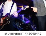 stylish guitarist playing on a... | Shutterstock . vector #443040442