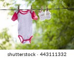 Baby Clothes Hanging On The...