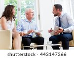 Small photo of Financial advisor consulting couple in retirement planning in modern, luminous office