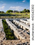 Small photo of Classical greek temple at ruins of ancient city Paestum, Italy