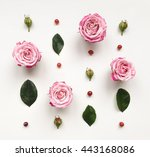 Stock photo decorative frame with pink bright roses and leaves on white background flat lay top view 443168086