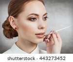 visagiste applying lipstick on... | Shutterstock . vector #443273452