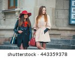 two pretty girls walking in the ... | Shutterstock . vector #443359378