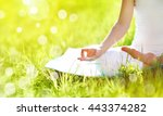 hand of a woman meditating in... | Shutterstock . vector #443374282