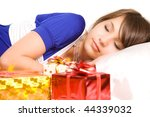 gift box near sleeping girl face - stock photo