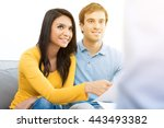 Small photo of Young mixed race couple meeting with consultant (or counselor, financial adviser, real estate agent etc.)