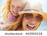 laughing young mother in a... | Shutterstock . vector #443504218