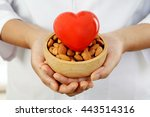 doctor holding a bowl of... | Shutterstock . vector #443514316