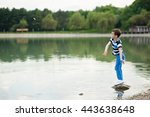 Active Boy Throws Small Stone...