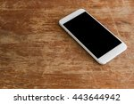 white mobile phone on a... | Shutterstock . vector #443644942