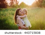 mom kisses and hugs daughter on ... | Shutterstock . vector #443715838