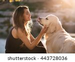 Stock photo beauty woman with her dog playing outdoors 443728036