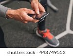 smartphone closeup at the gym.... | Shutterstock . vector #443749552