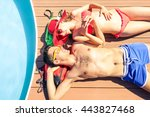 young couple sun tanning at... | Shutterstock . vector #443827468
