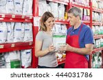 Stock photo salesman assisting customer in buying pet food at shop 444031786
