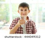 Cute Boy Drinking Water On...