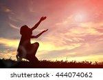 silhouette hand girl praying at