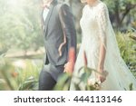 happy bride and groom on their... | Shutterstock . vector #444113146