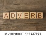 Small photo of ADVERB word on wooden cubes