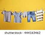 baby clothes hanging on rope on ... | Shutterstock . vector #444163462