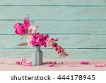 pink peony on old blue... | Shutterstock . vector #444178945