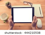 hand holding tablet similar to... | Shutterstock . vector #444210538