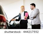 salesperson showing vehicle to... | Shutterstock . vector #444217552