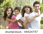portrait of happy family in park | Shutterstock . vector #44424757