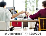 fist bump colleagues... | Shutterstock . vector #444269305