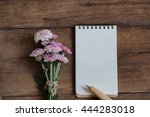 flowers and blank paper note on ... | Shutterstock . vector #444283018
