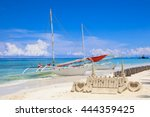 Sand Castle And A Boat On Whit...