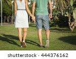 loving couple walking on the... | Shutterstock . vector #444376162
