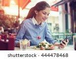 beautiful young woman using an... | Shutterstock . vector #444478468