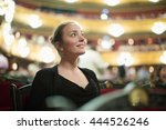 Small photo of Portrait of happy girl in auditorium of opera teatre