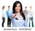 smiling woman pointing her... | Shutterstock . vector #444558442