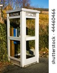 A White French Phone Booth In A ...