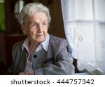 An Elderly Woman  Sitting At...