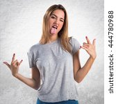 young girl making horn gesture... | Shutterstock . vector #444780988