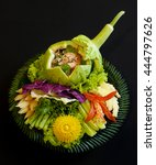 Small photo of authentic thai cuisine - sangwa pla dook foo - thai grilled shrimp salad with traditional herbs, served with vegetables and crispy fluffy catfish