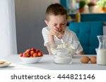 7 year old boy mixing white... | Shutterstock . vector #444821146