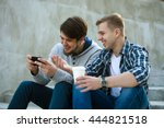 two guys sitting on stairs with ... | Shutterstock . vector #444821518