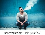 men with beard vaping outdoor... | Shutterstock . vector #444835162