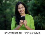 cheerful young woman text... | Shutterstock . vector #444884326