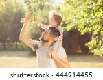 piggyback of baby and dad | Shutterstock . vector #444914455