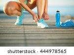 running shoes   woman tying...   Shutterstock . vector #444978565