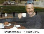 attractive smiling mid adult... | Shutterstock . vector #445052542