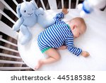 sleeping baby and his toy in... | Shutterstock . vector #445185382
