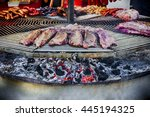a huge circular grill loaded... | Shutterstock . vector #445194325