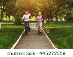 boy and girl run in a park with ... | Shutterstock . vector #445272556