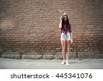 portrait of a girl tourist in a ... | Shutterstock . vector #445341076
